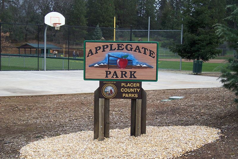 Applegate Park Sign in Front of Basketball Court